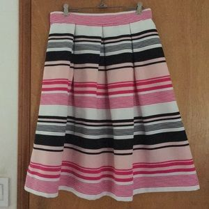 Long pleated pink black and white striped skirt